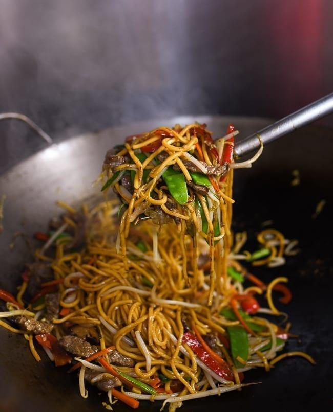 Lifting lo mein with wok spatula, thewoksoflife.com