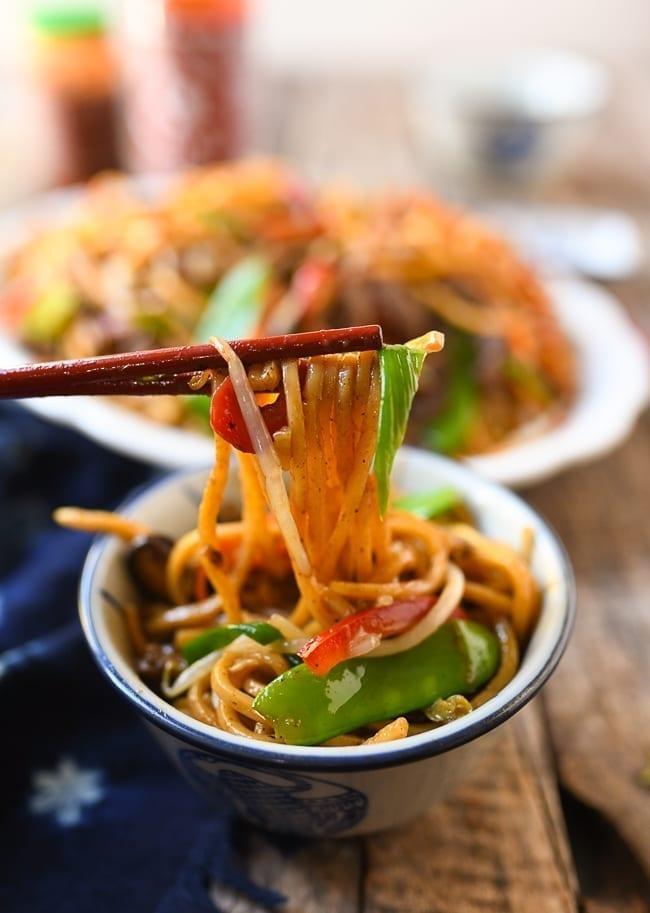 Lifting lo mein with chopsticks, thewoksoflife.com
