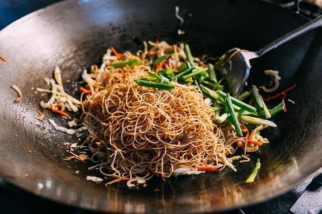 Adding rice noodles and scallions to wok, thewoksoflife.com