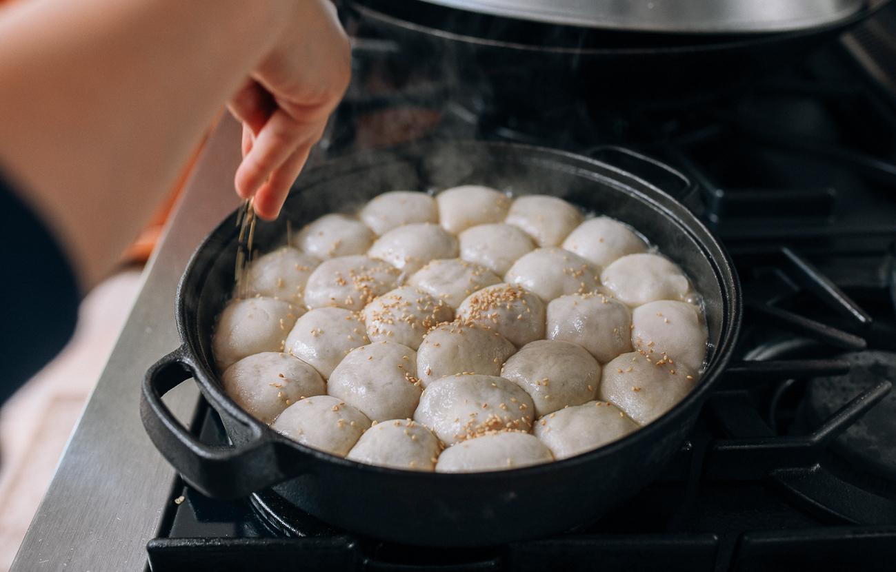 Sprinkling buns with sesame seeds, thewoksoflife.com