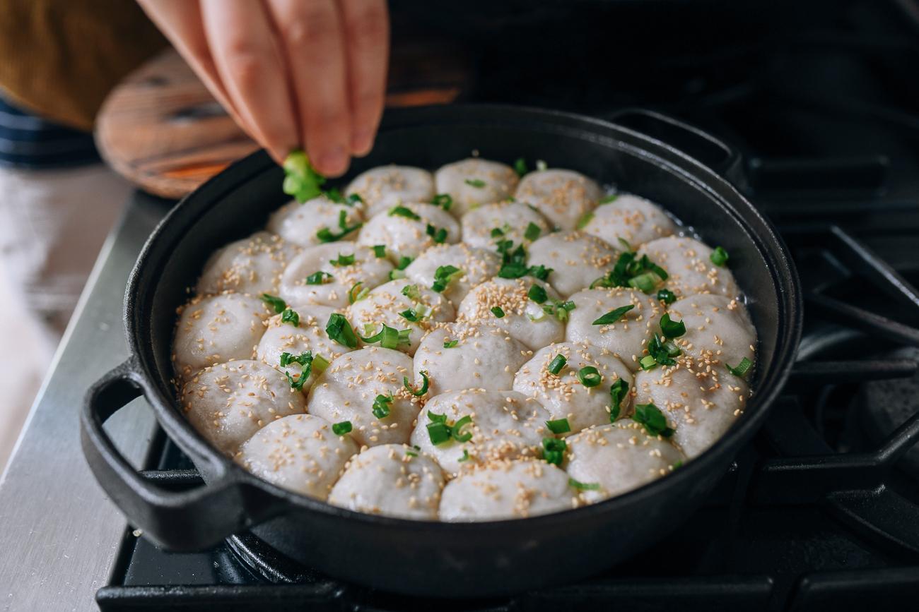 Sprinkling buns with scallions, thewoksoflife.com
