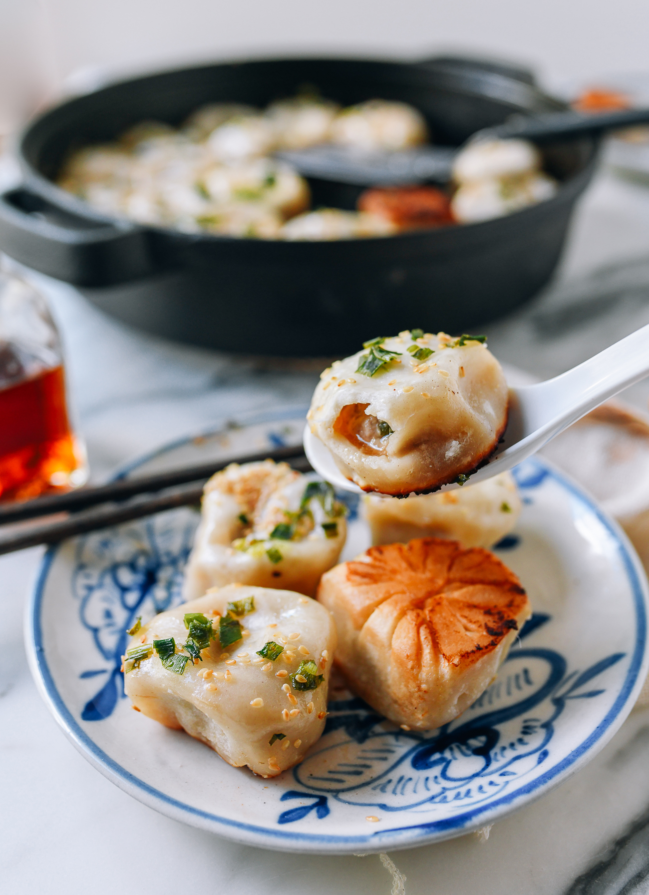 Shanghai Pan-fried Pork Bun (Shengjian Mantou) with soup inside, thewoksoflife.com