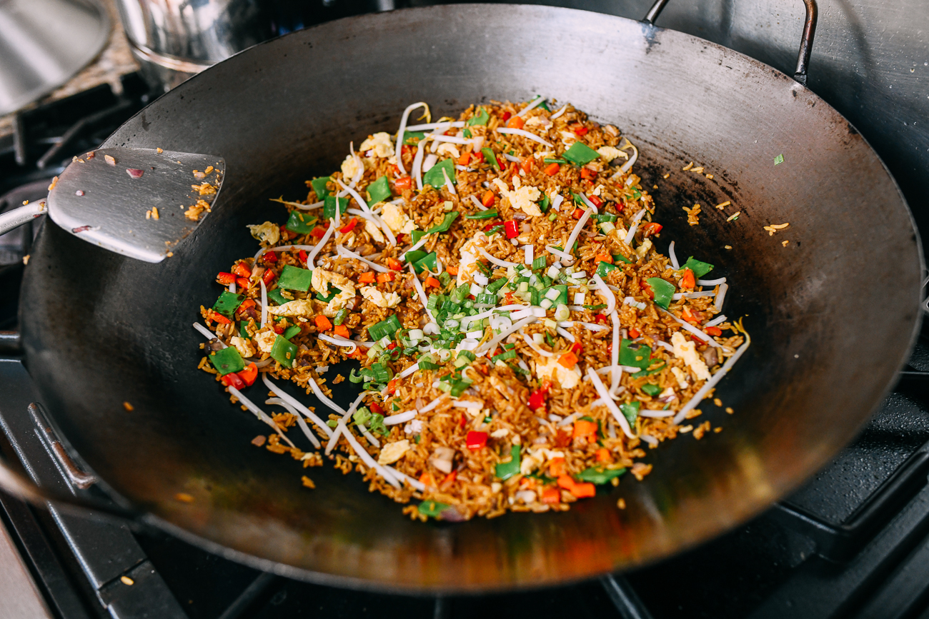Adding scallions to fried rice