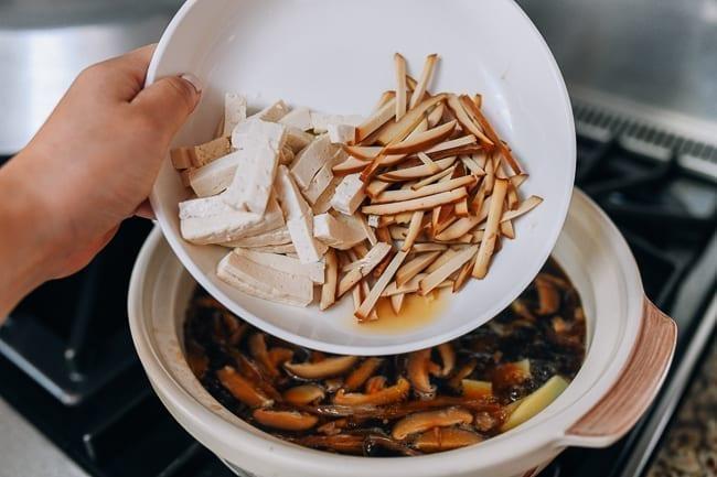 Adding spiced tofu and firm tofu to soup, thewoksoflife.com