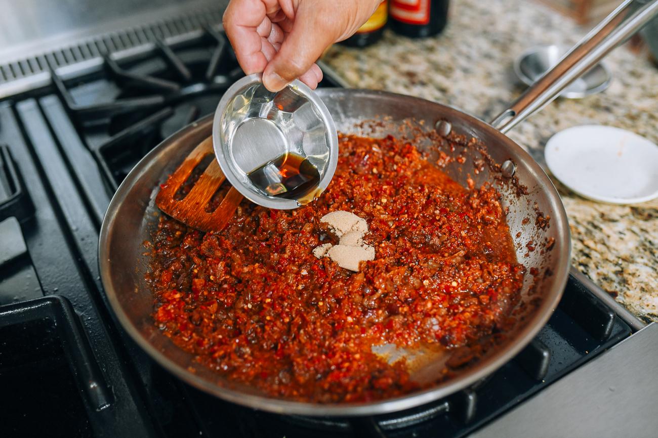 Adding fish sauce and brown sugar to belacan sauce