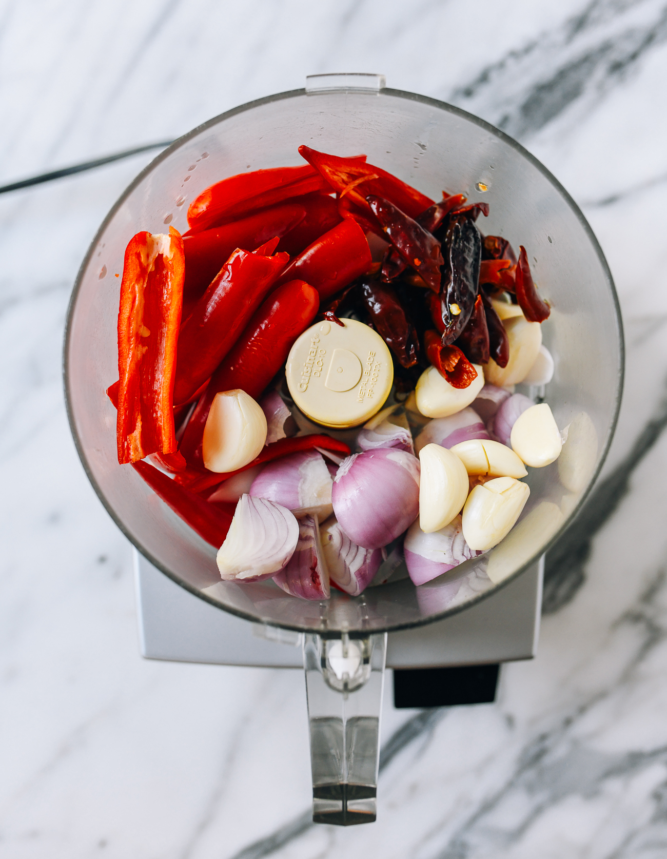 Chilies, garlic, and shallots in food processor