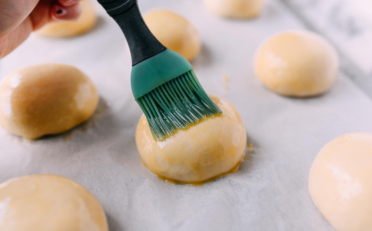 Brushing bun with egg wash