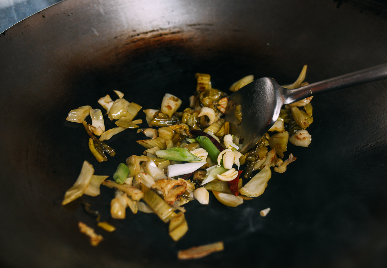 Stir-frying mustard greens with aromatics