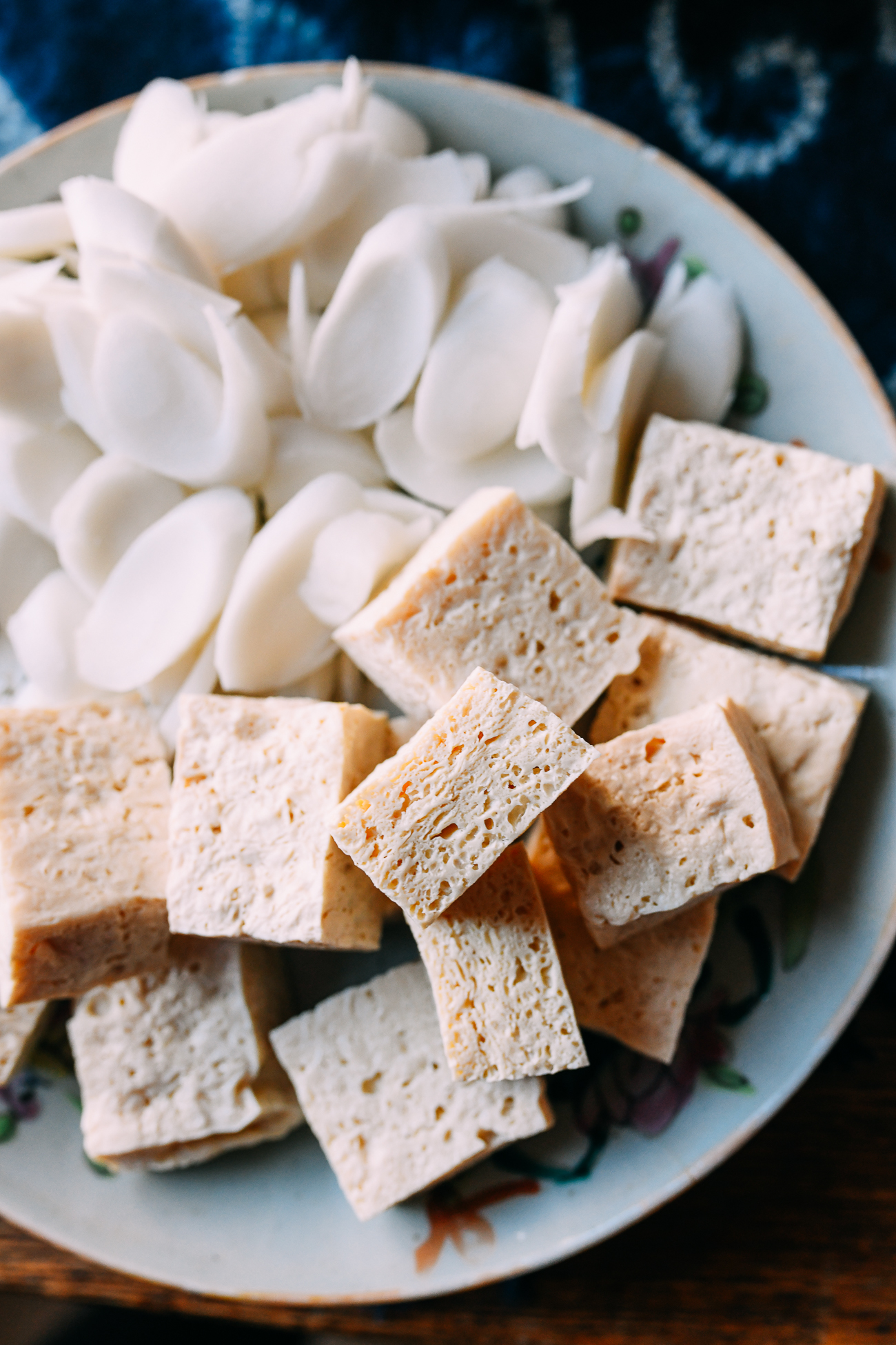 Frozen tofu with rice cakes on plate for hot pot