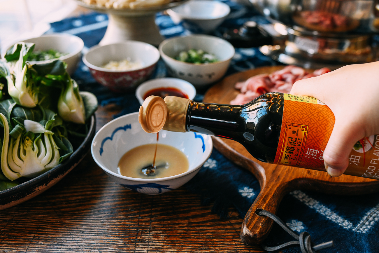 Adding soy sauce to dipping sauce