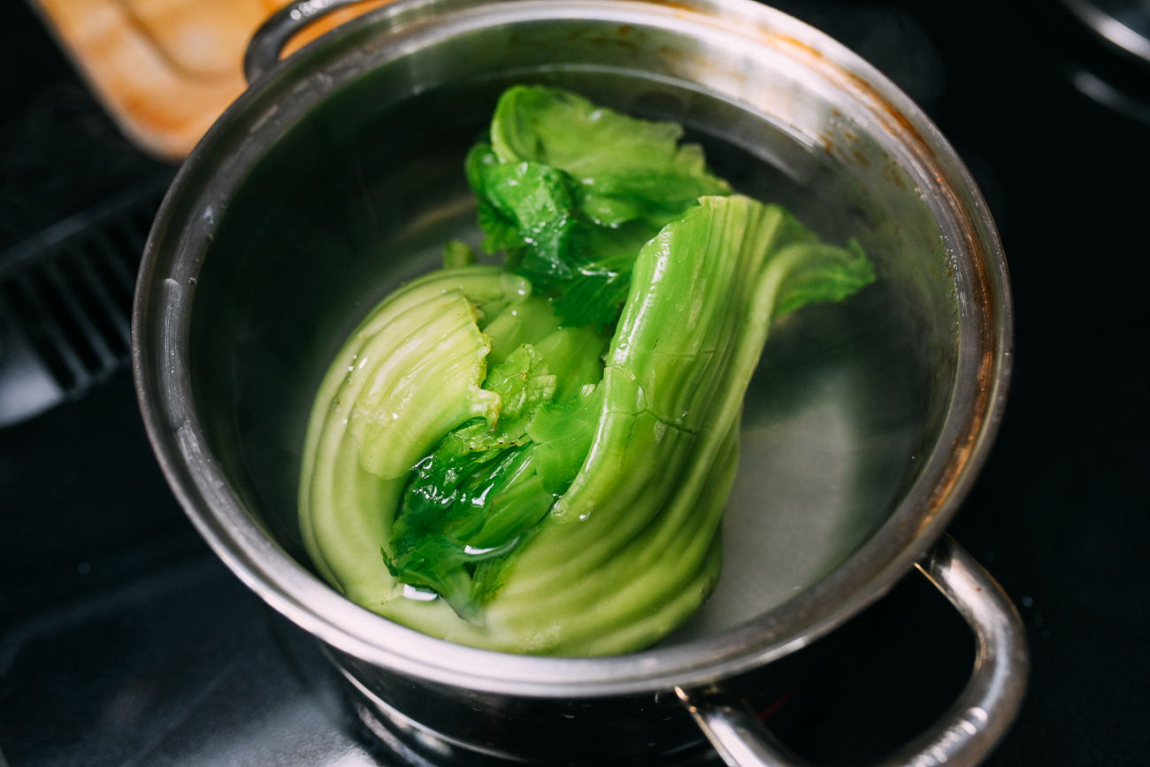 Blanching head mustard in salted water