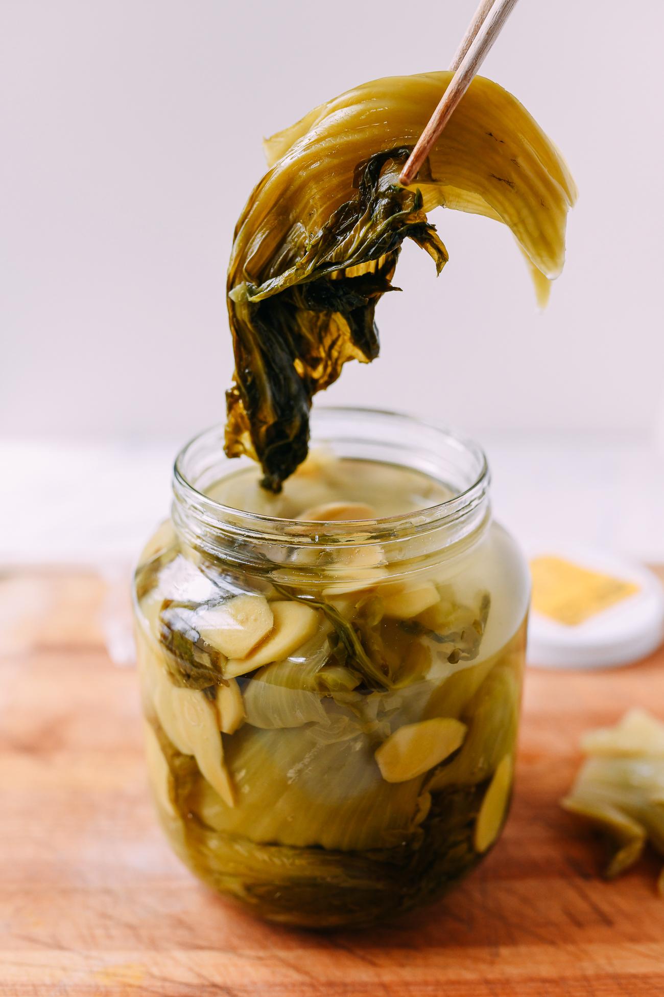 Removing pickled mustard greens from jar