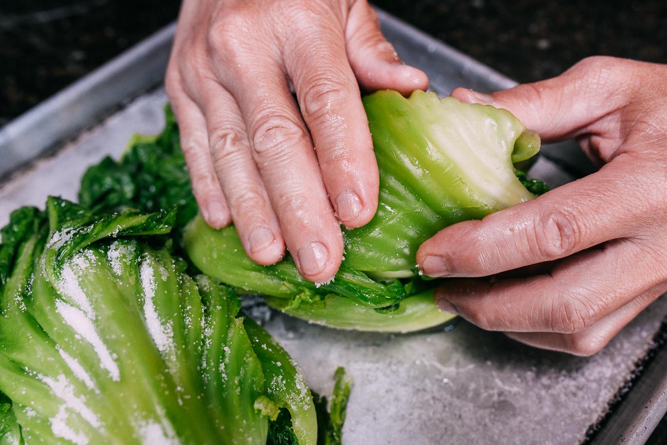 Rubbing salt into mustard greens