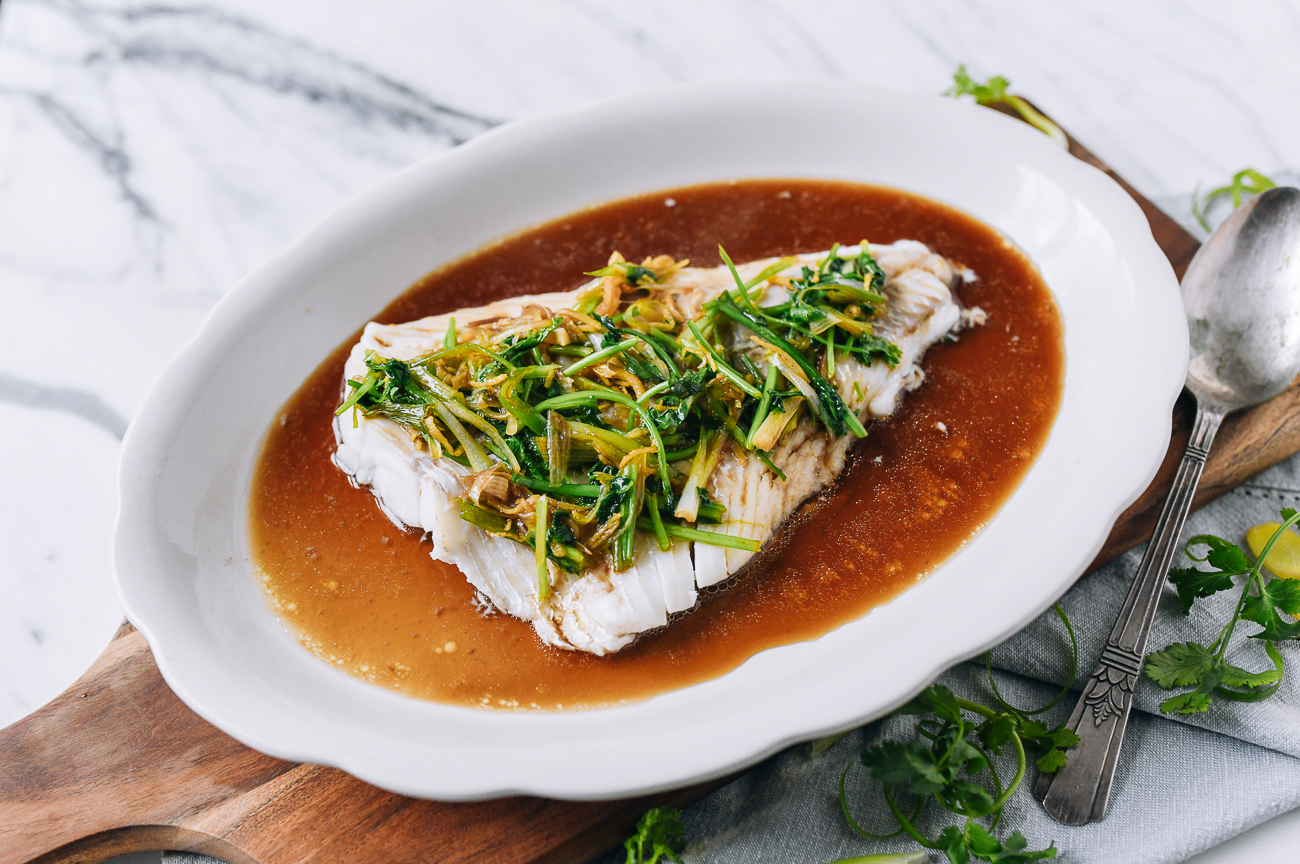 Fish fillet with scallion ginger soy sauce over the top