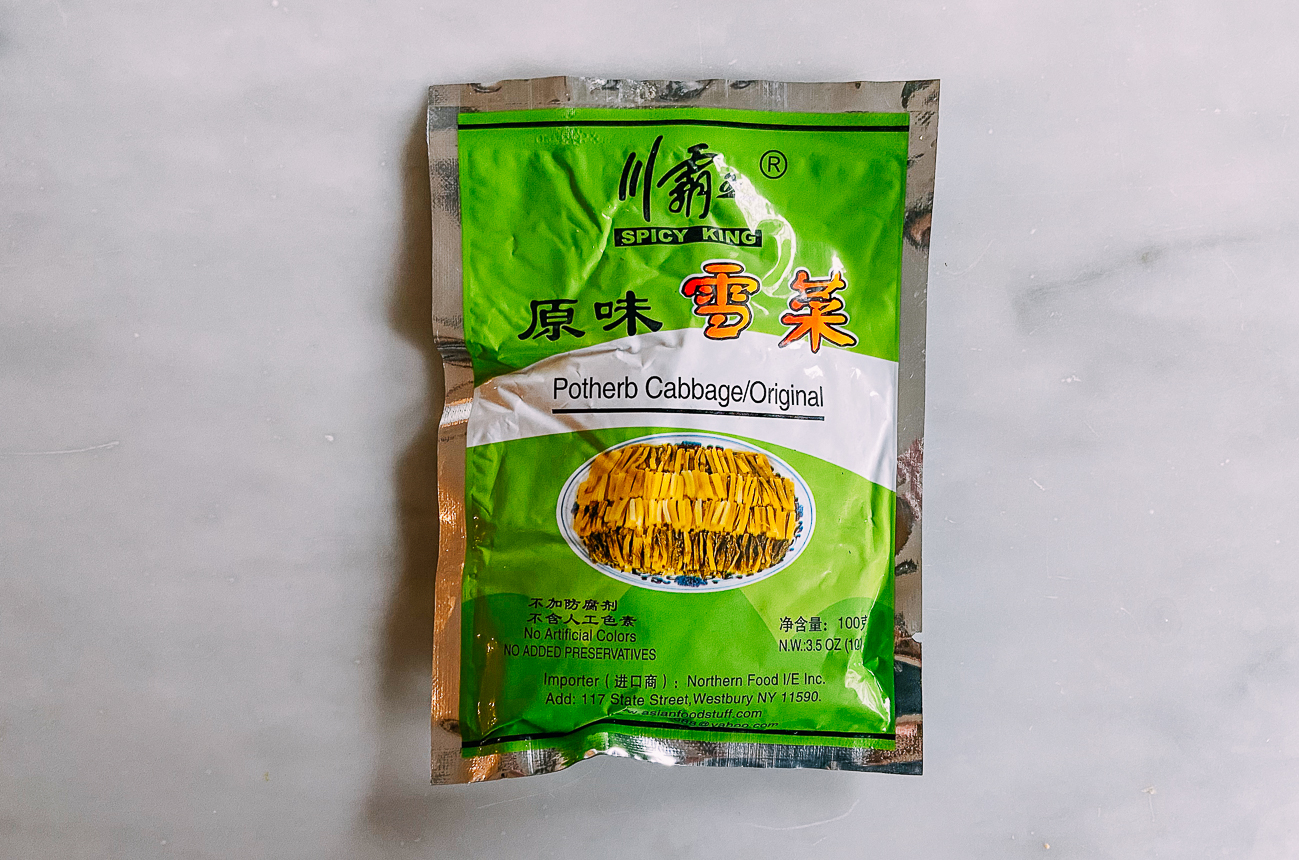 Vacuum package of Chinese pickled mustard greens AKA potherb cabbage