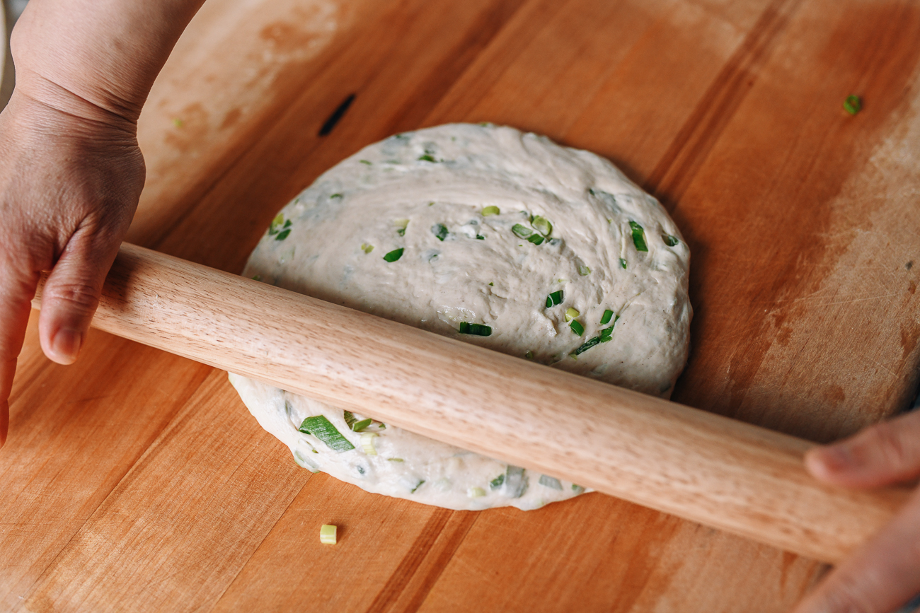 Rolling dough into a circle