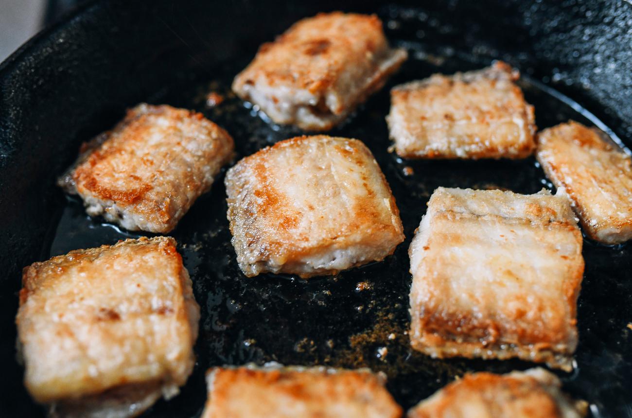 Belt fish frying in oil