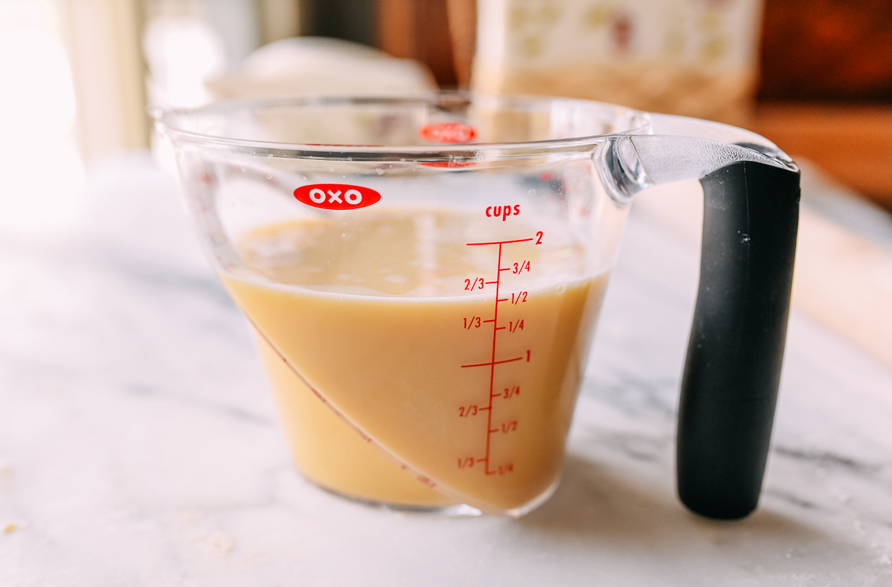 Custard filling in measuring cup