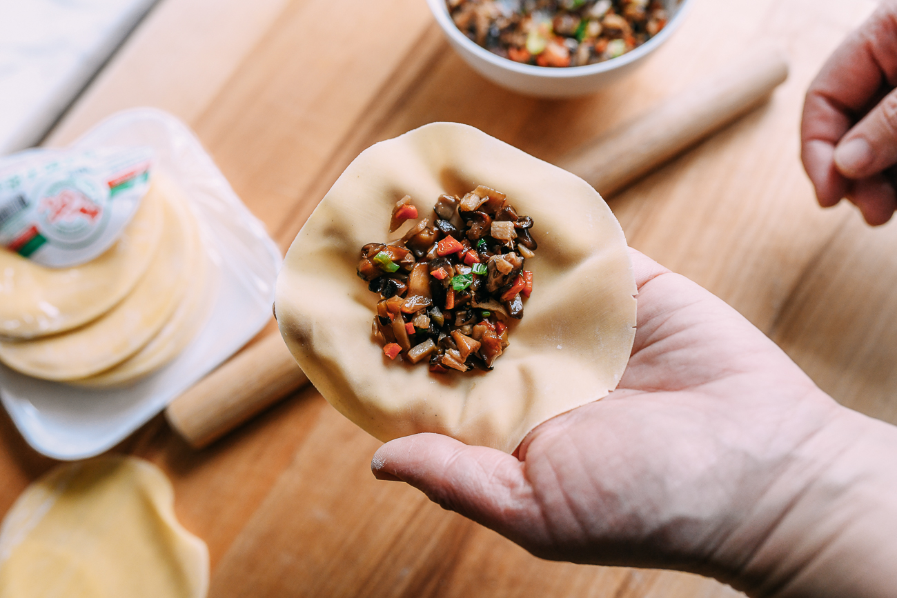 Vegetable filling in middle of dumpling wrapper