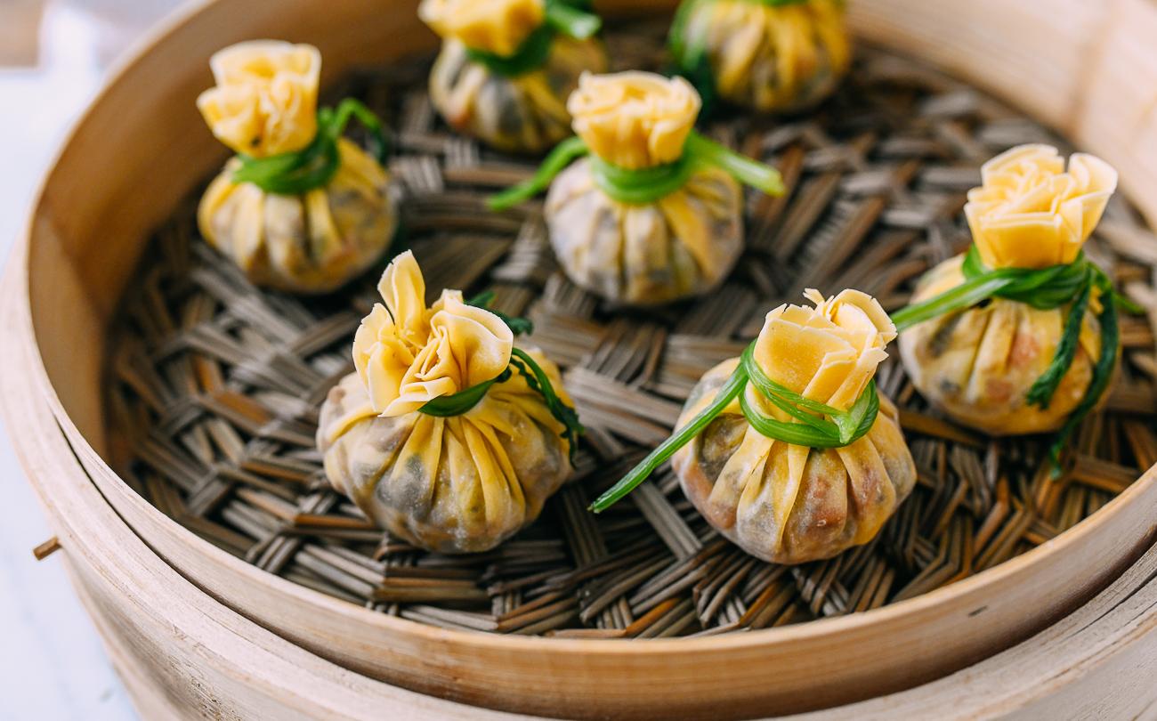 Money bag dumplings in bamboo steamer before cooking