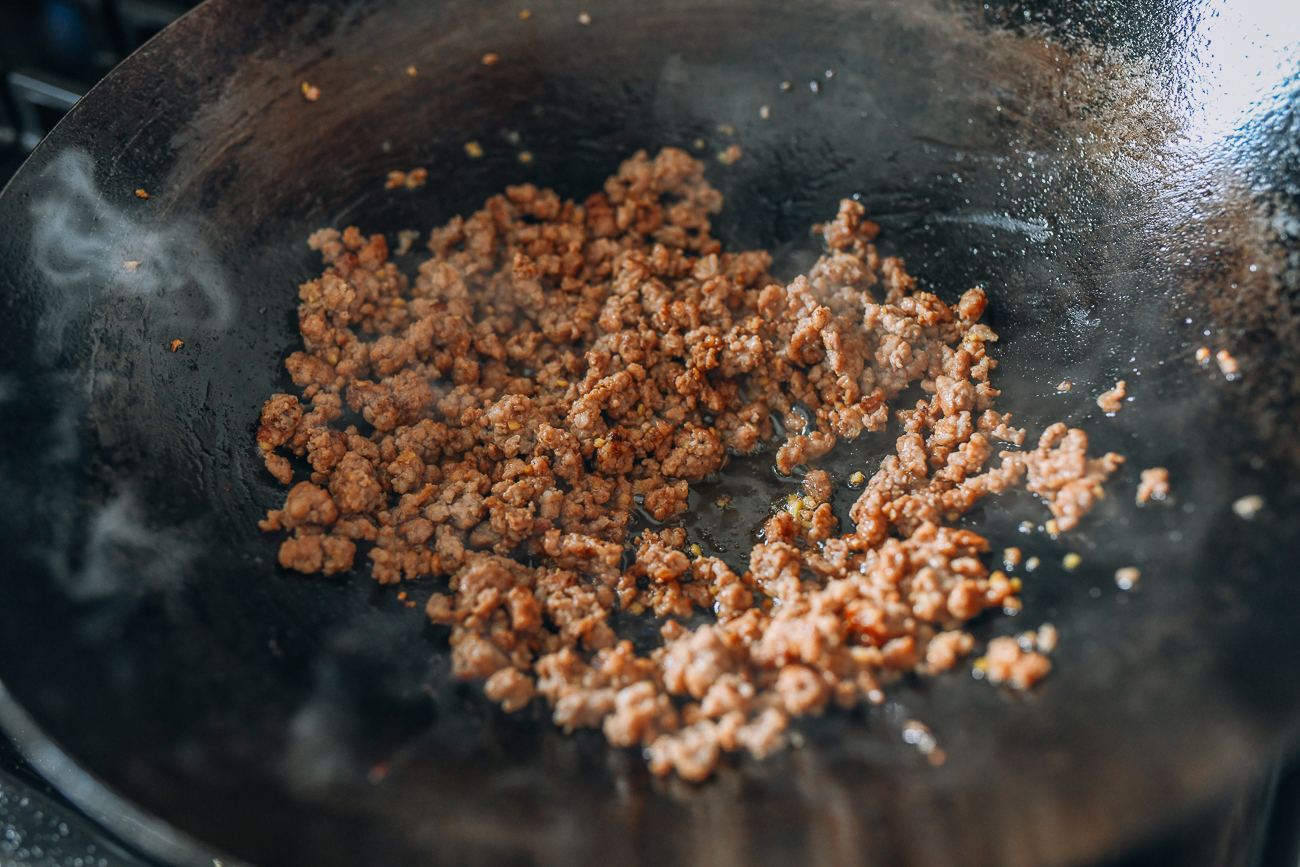 Browning ground pork in wok