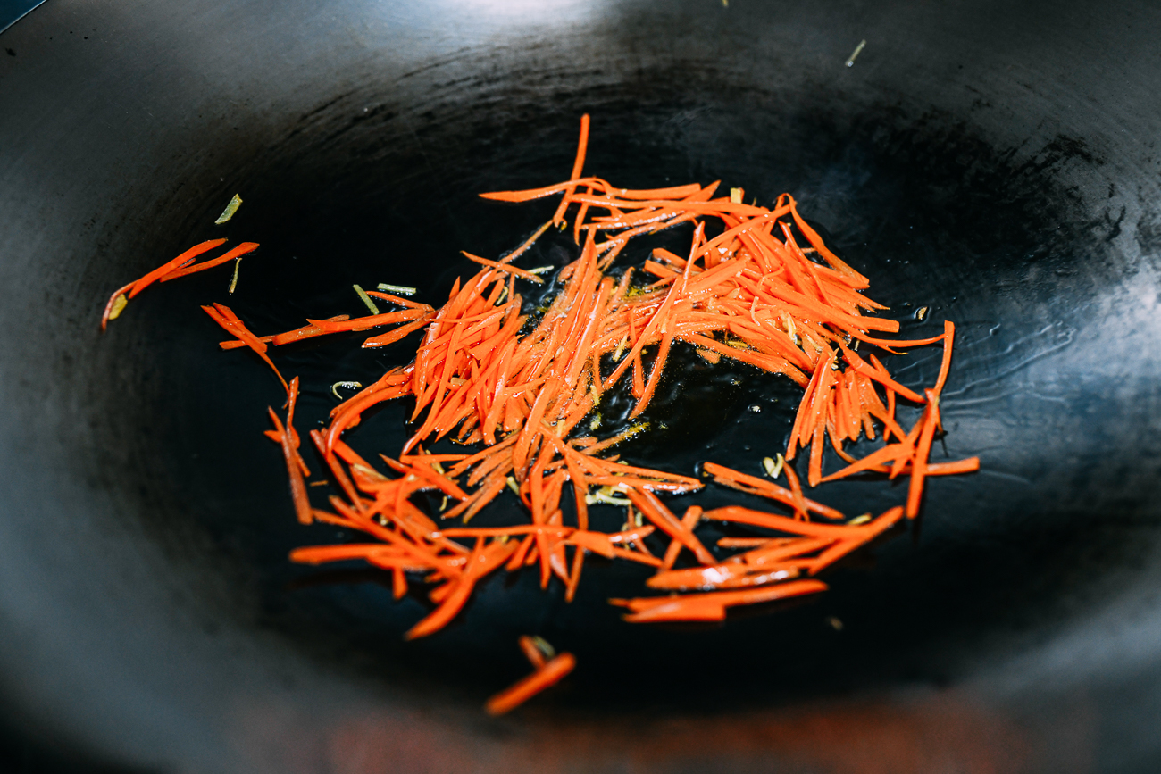 Stir-frying julienned carrots
