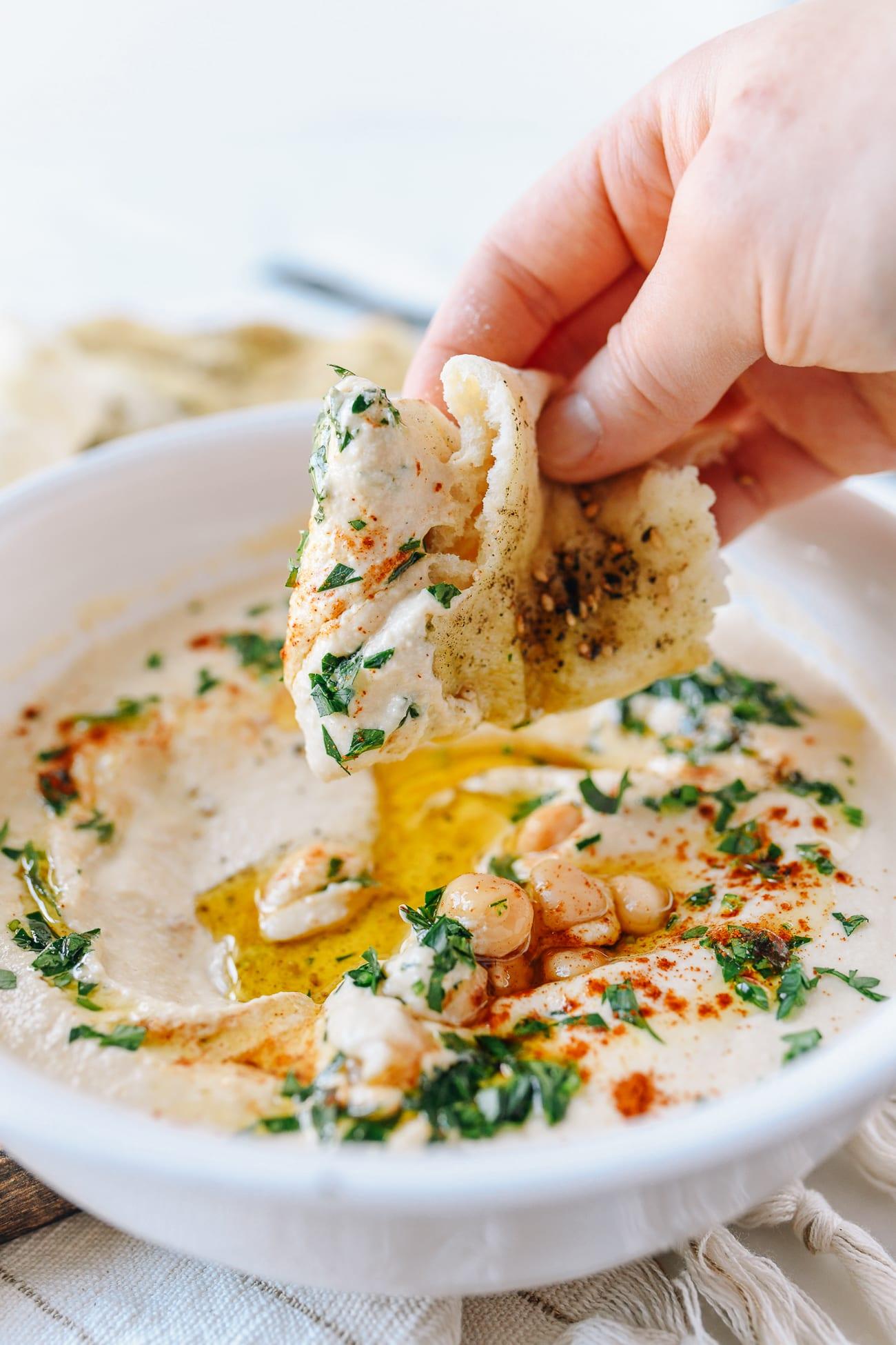 Dipping Laffa Bread into Hummus