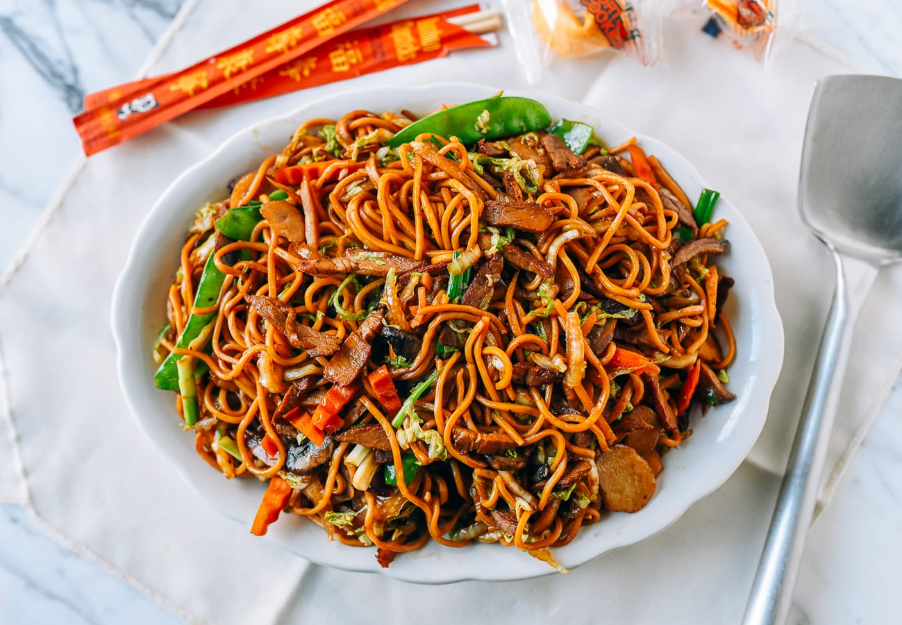 Plate of Roast Pork Lo Mein with chopsticks and fortune cookies