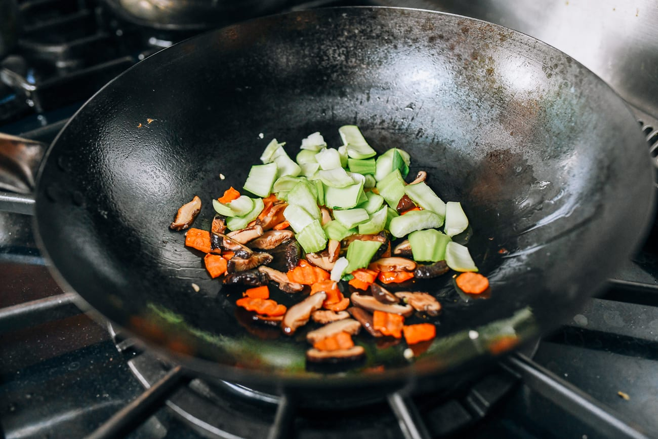 Adding bok choy stems to wok