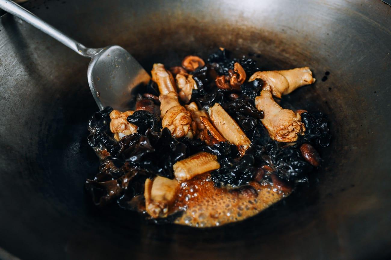 Stirring seasonings into chicken and mushrooms