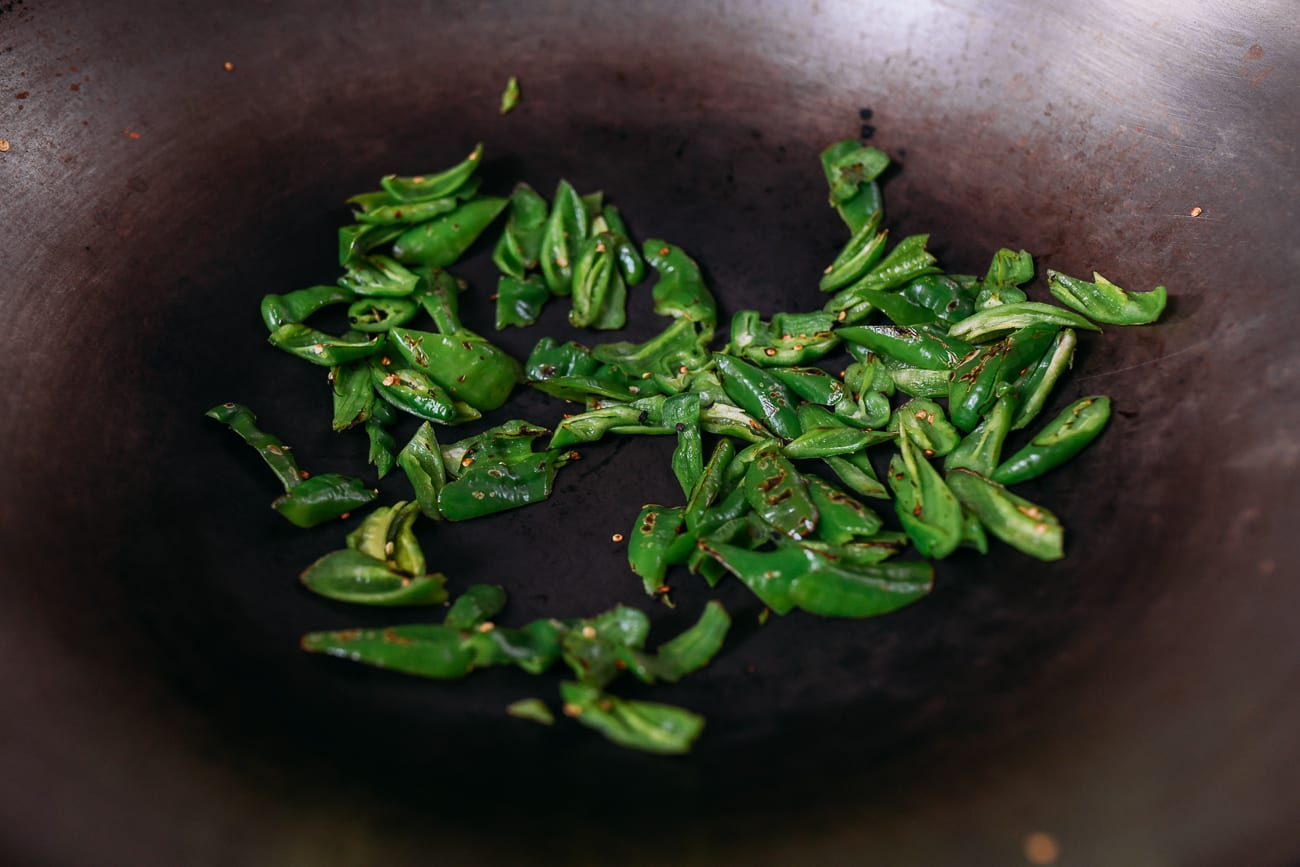 Dry frying peppers in wok