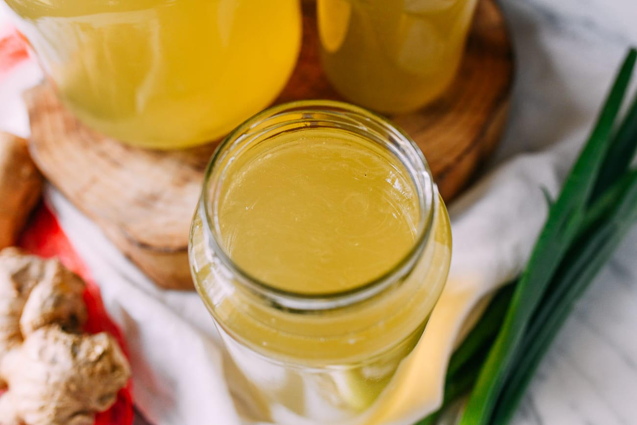 Clear chicken broth stored in glass jar