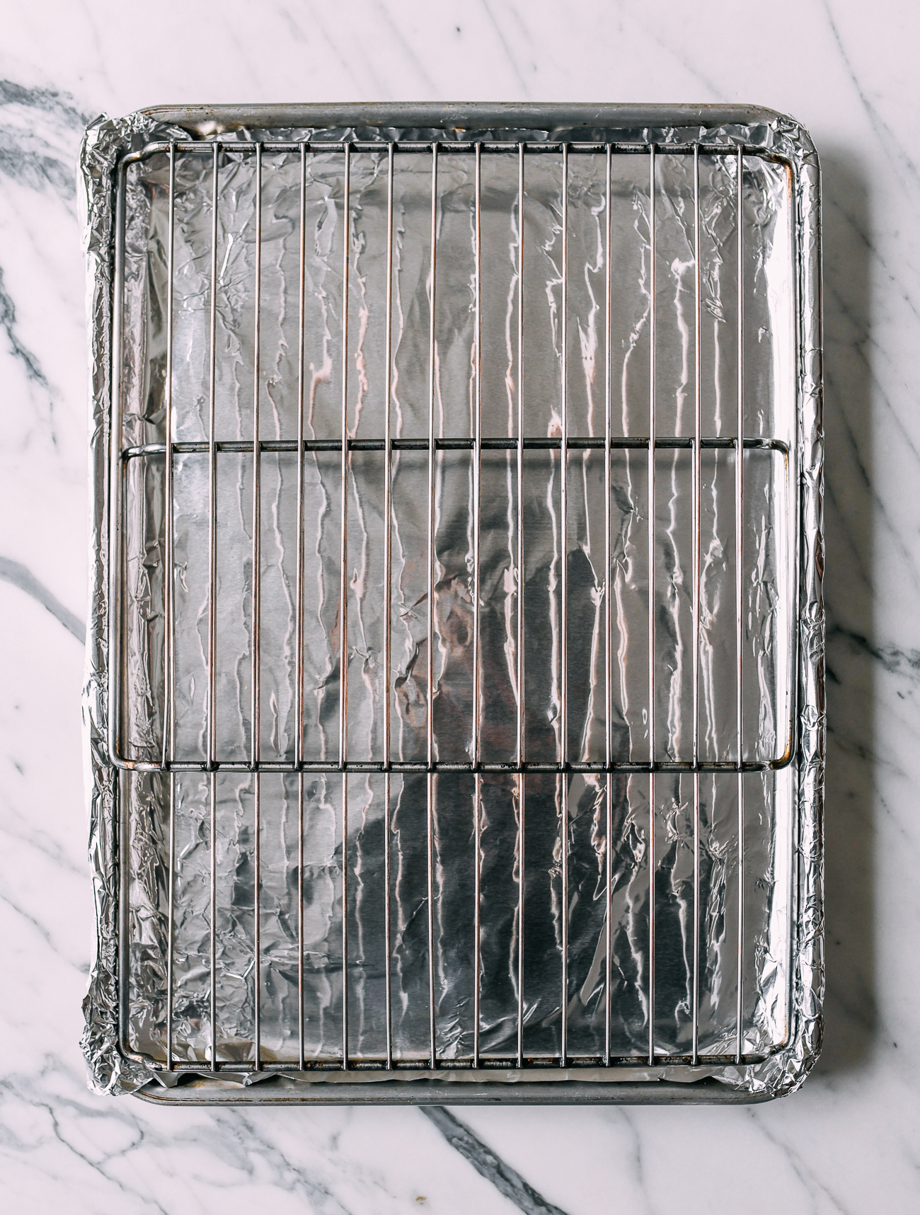 Foil-lined sheet pan with metal rack on top