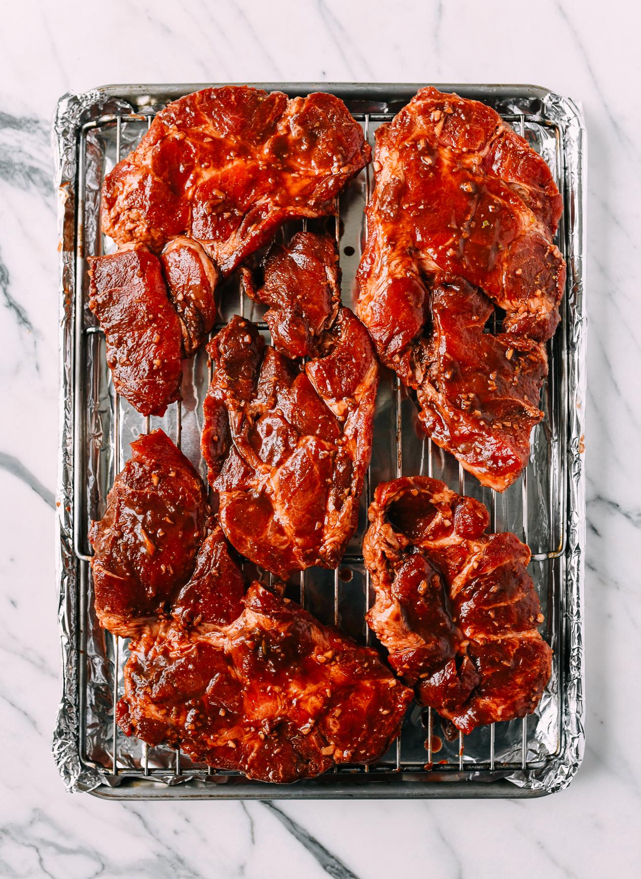 Pork pieces on roasting pan