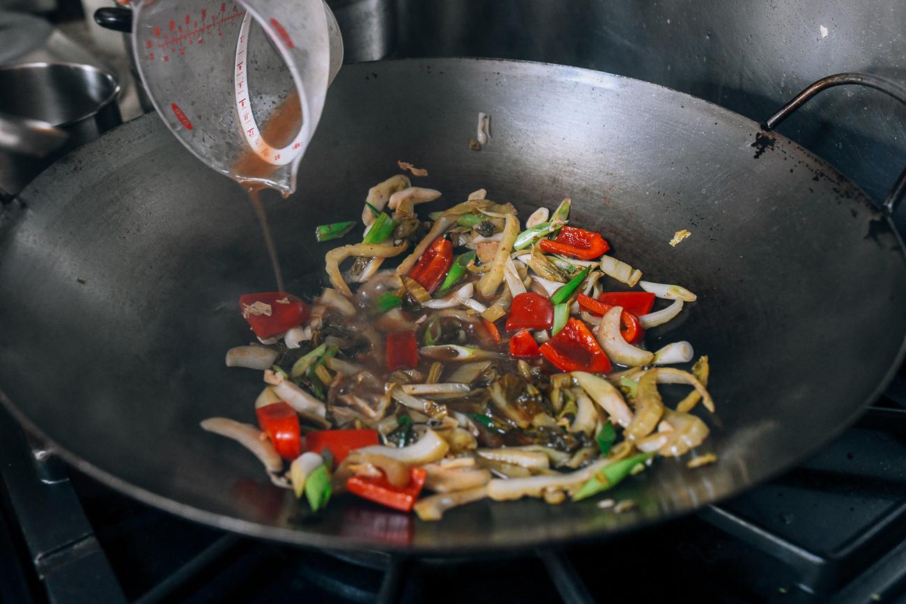Adding Shaoxing wine to wok