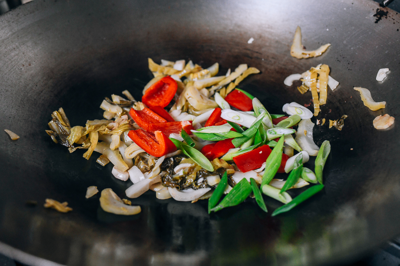Adding the scallions and bell peppers