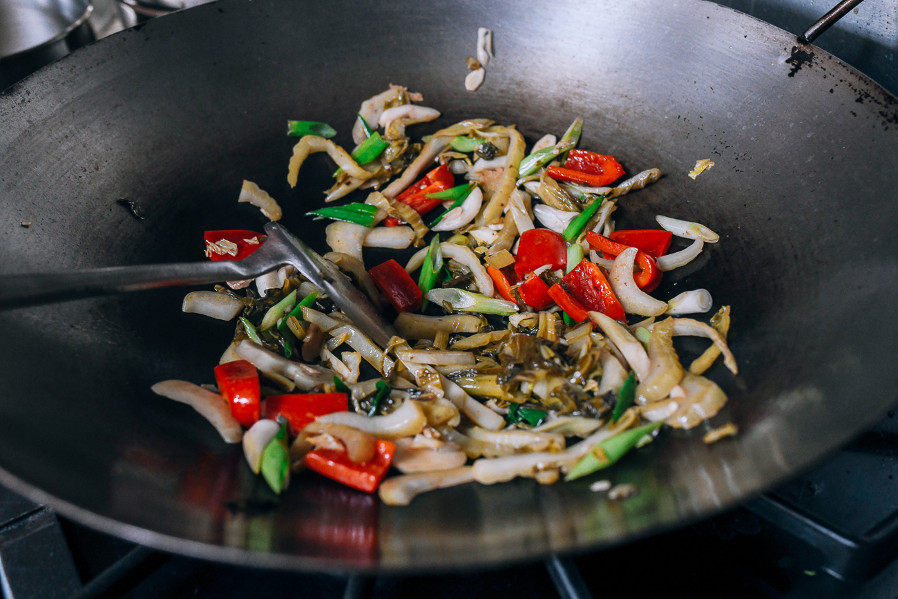 Stir-frying haam choy and vegetables