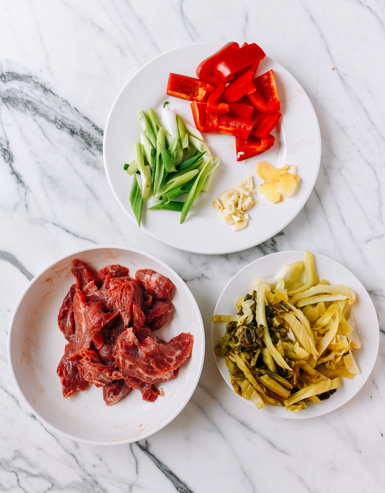 Marinated flank steak, scallions, peppers, garlic, ginger, and haam choy