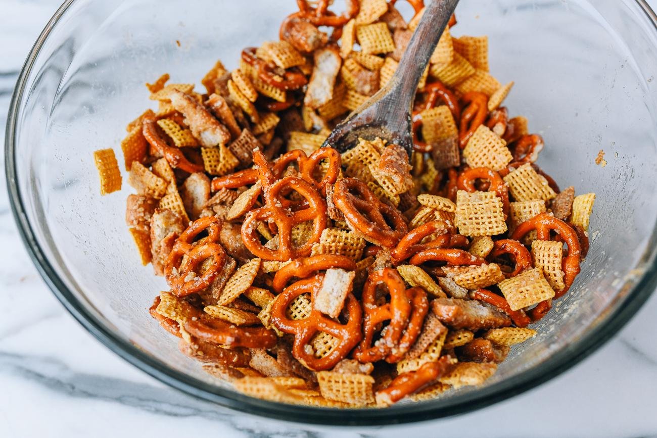 Stirring seasoning into snack mix