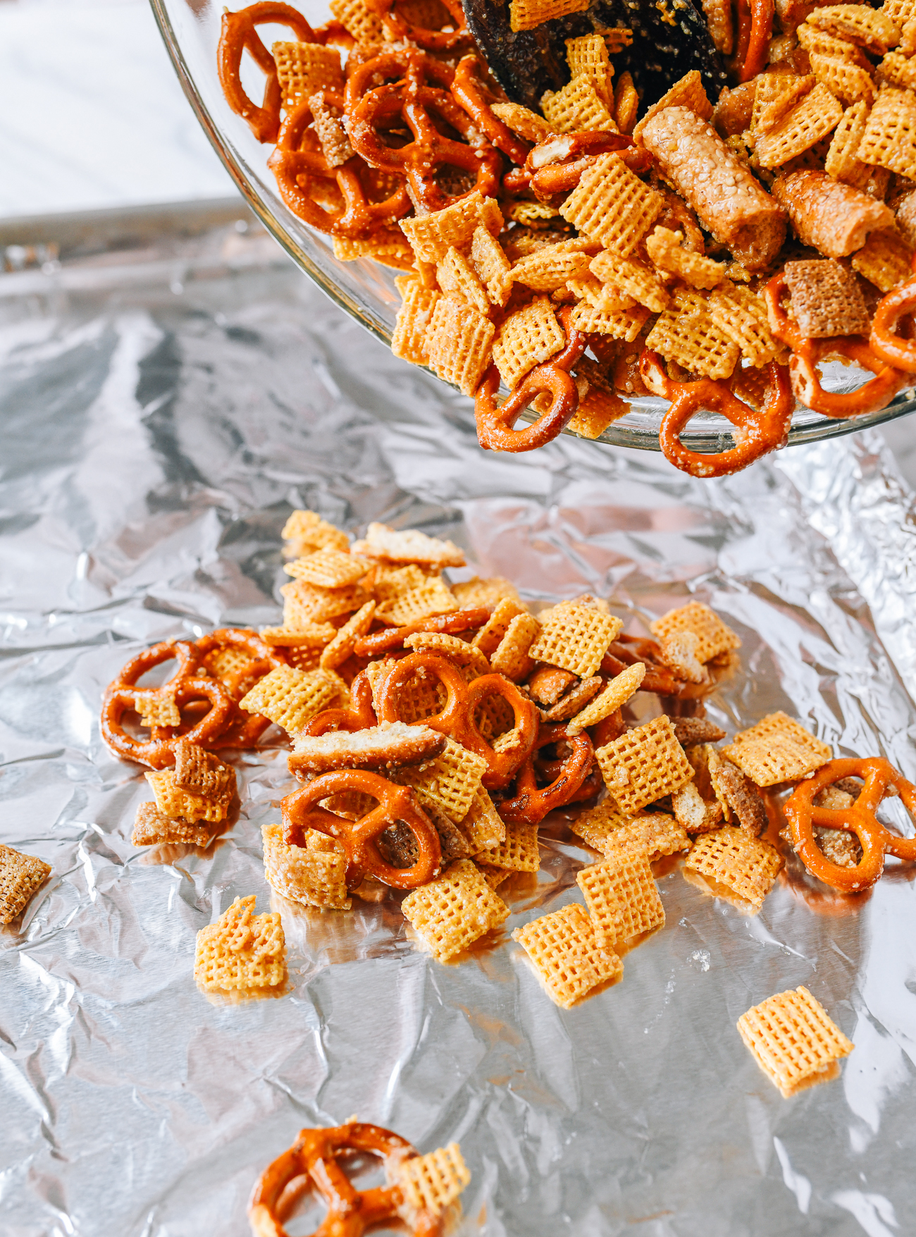 Transferring homemade chex mix to baking sheet
