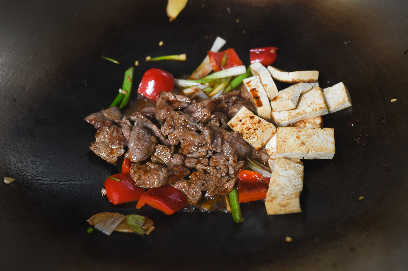 vegetables, beef, and tofu in wok