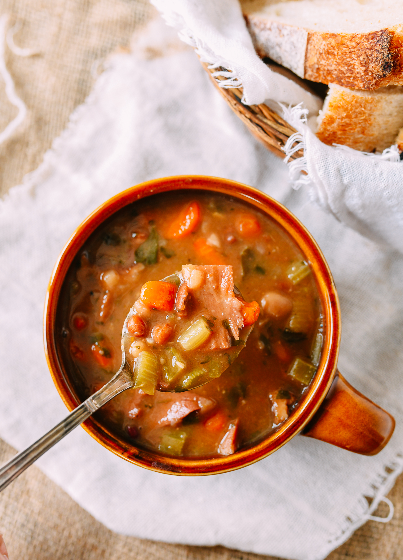 Spoon full of ham and bean soup