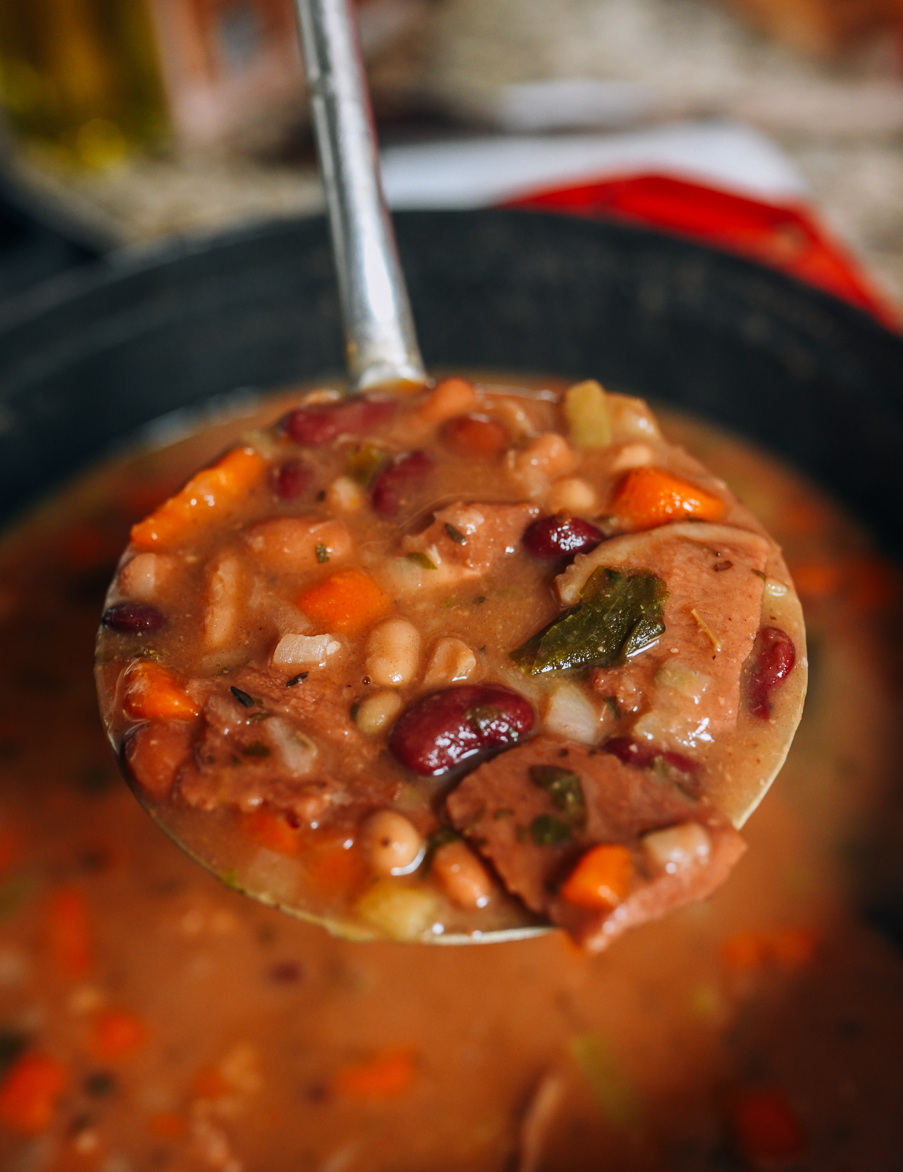 Ladle full of ham and bean soup
