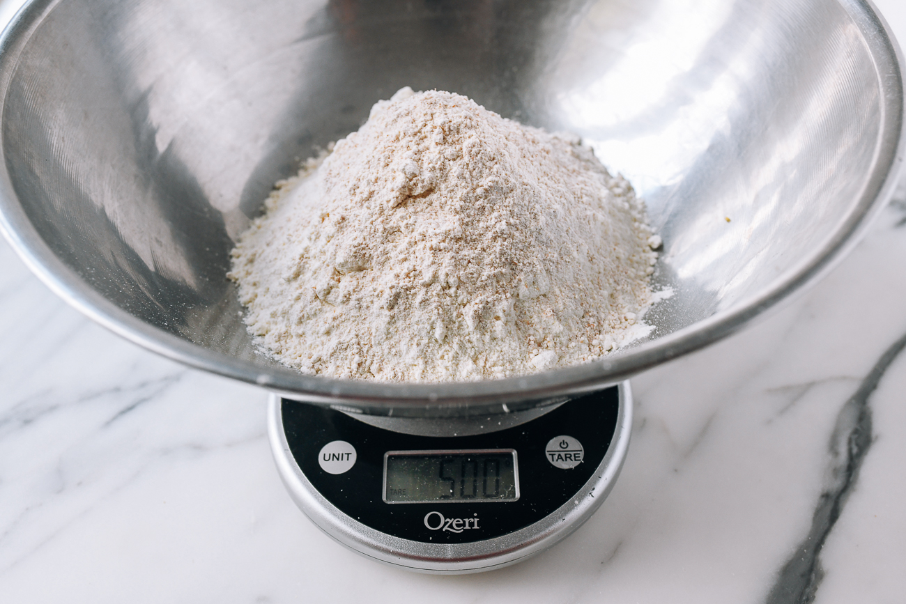 500g of bread flour and whole wheat flour in stainless steel bowl