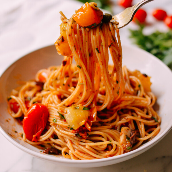 Forkful of Spaghetti with Roasted Cherry Tomato Puttanesca Sauce