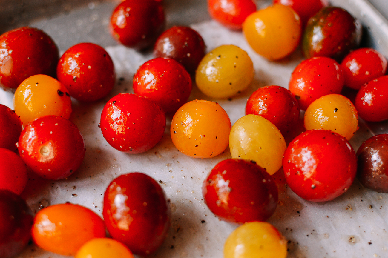 Cherry Tomatoes on parchment lined baking sheet