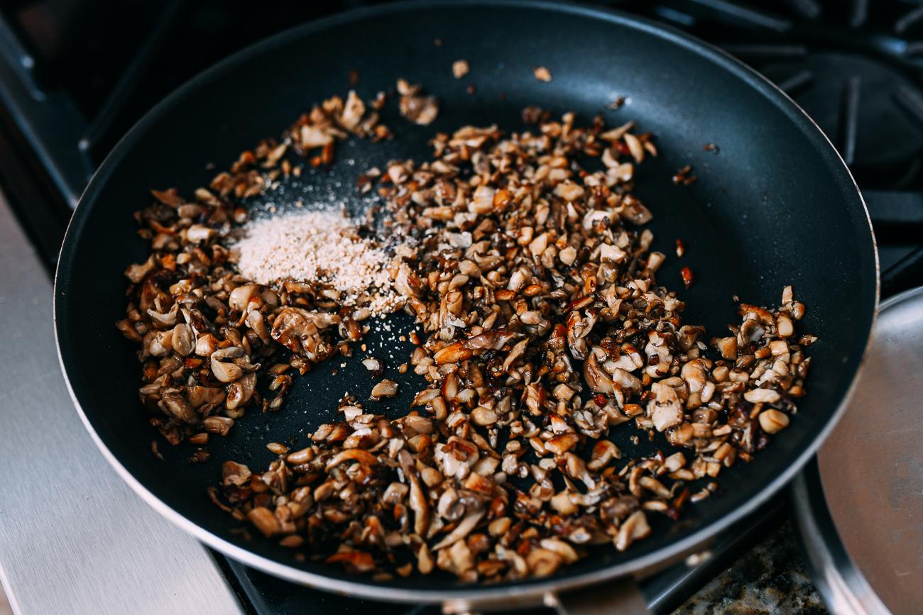Adding toasted rice powder to mushrooms