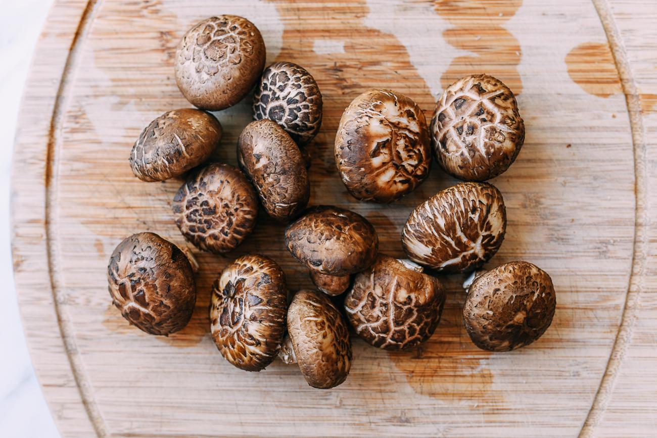 Fresh shiitake mushrooms on cutting board