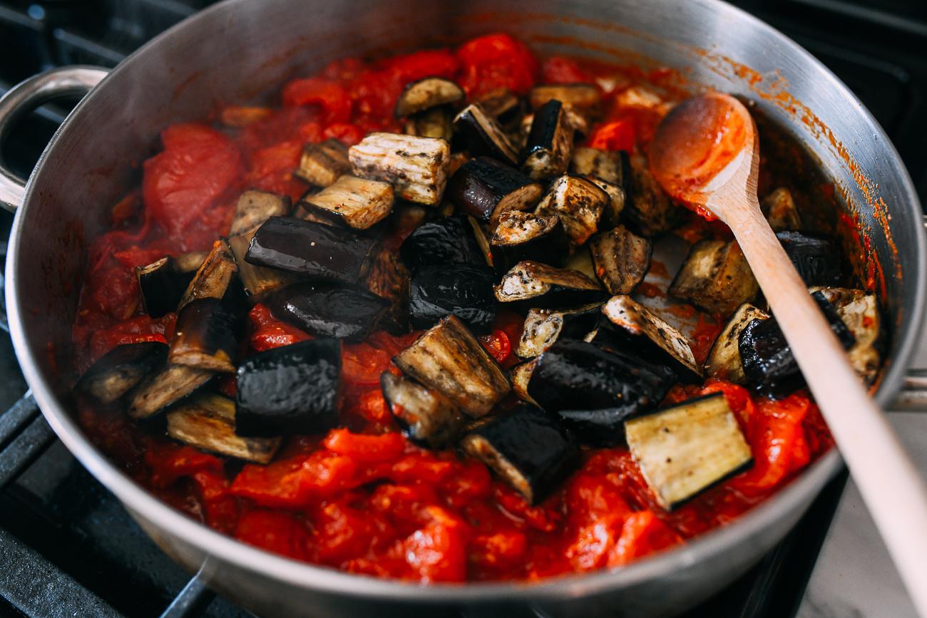Adding eggplant to pan