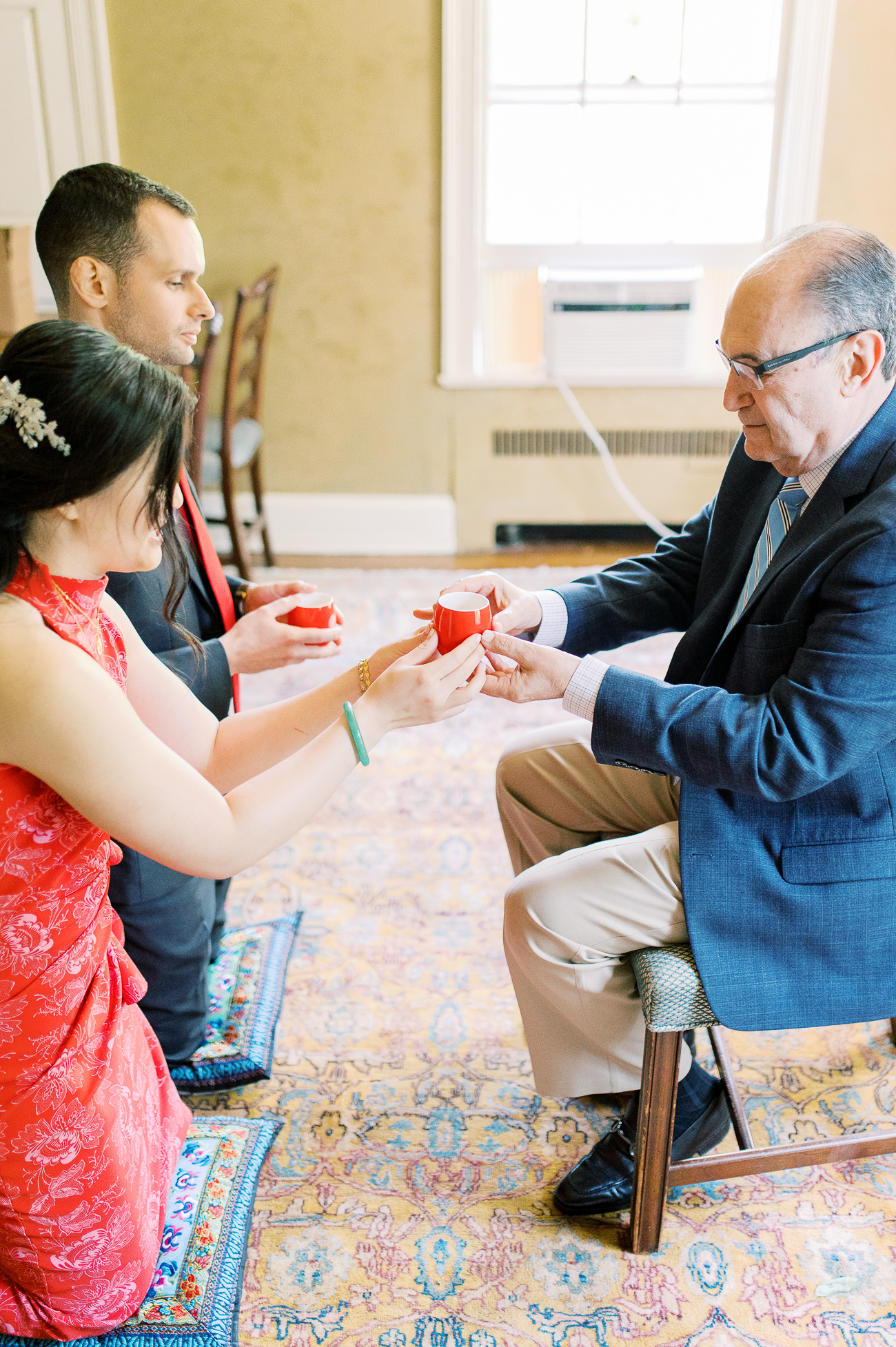 Sarah and Justin serving tea to Justin's dad